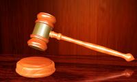 权健公司束某某等16人被依法批准逮捕